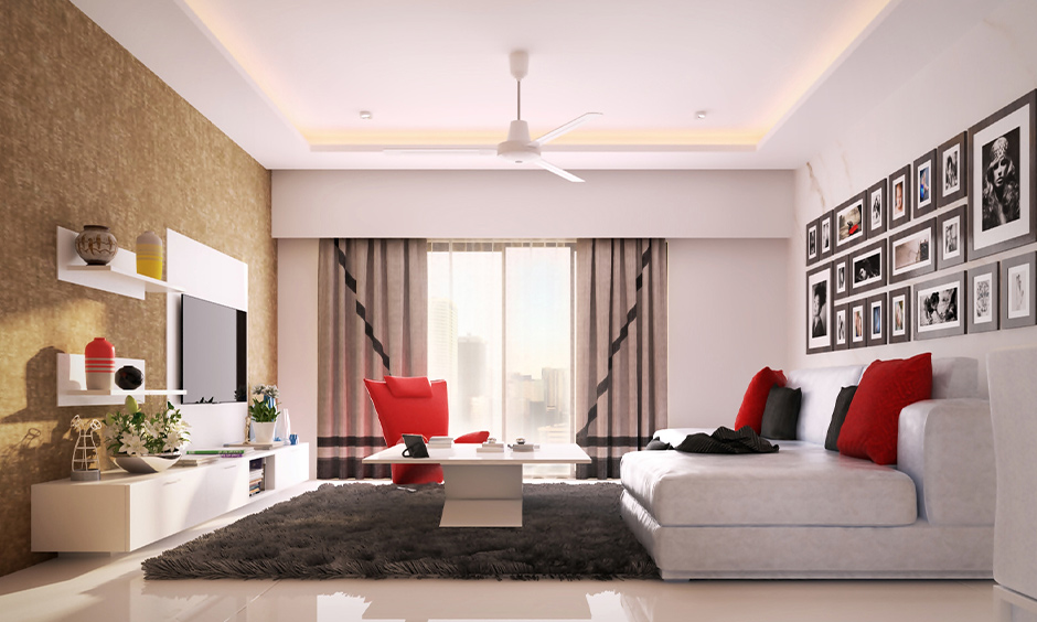 White tile living room idea, vitrified white tiles with glass finish lends a smooth and clean look to space.