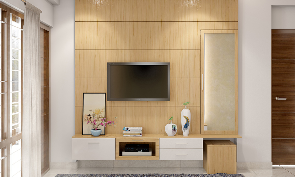 Minimal wall fitted dressing table design with tv unit attached looks minimalistic in the bedroom.