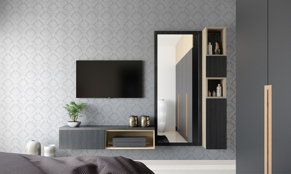 Modern wall mounted dressing table design in pastel and white laminates with sleek drawers in the bedroom.