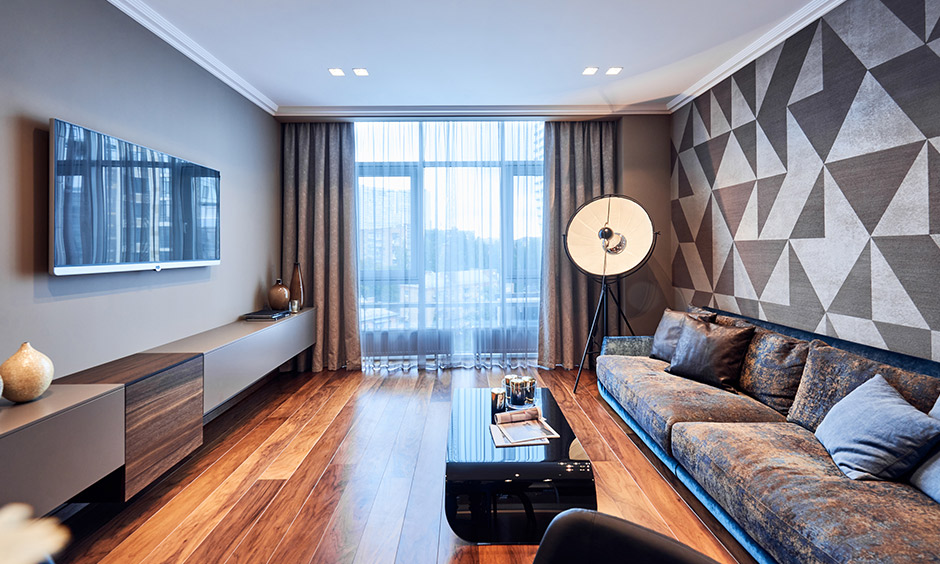 Living room laminate flooring in antique oakwood design lends warmth to the area and a classic look.