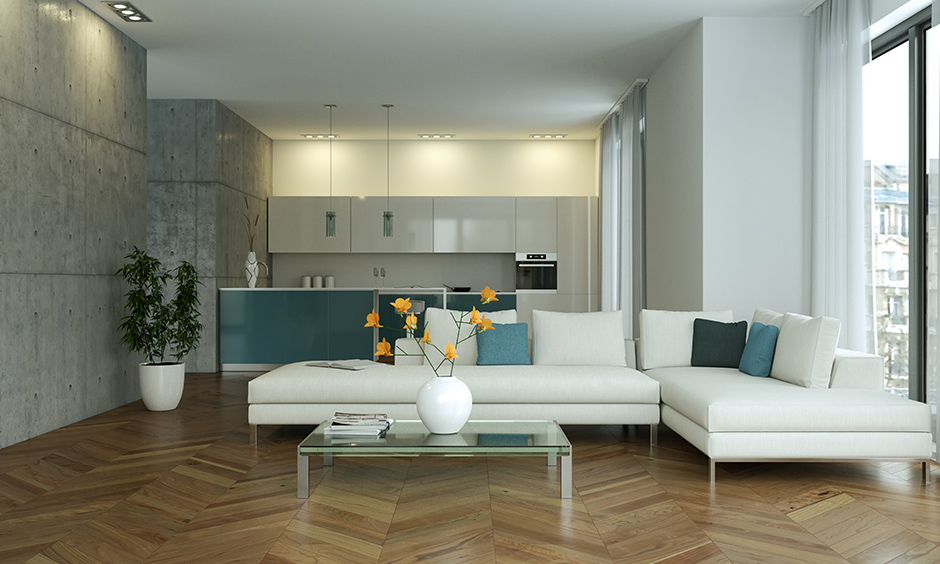 Living cum kitchen area wood flooring in a chevron pattern brings a modern look, laminated wooden flooring in India.