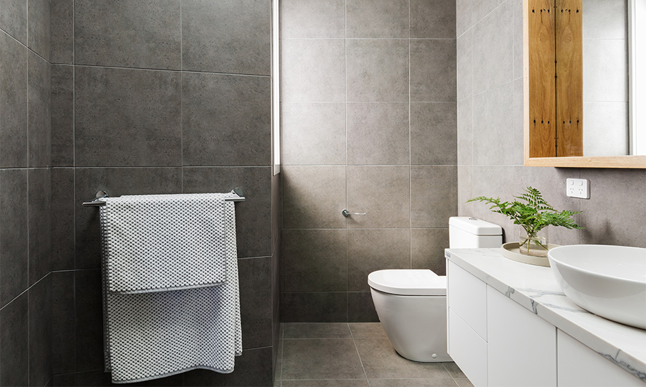 Modern bathroom tiles design with matte finish make the bathroom look spacious