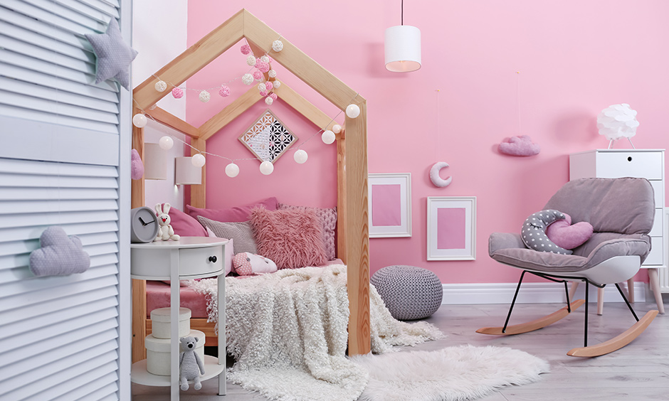 DIY girls room decorated with paper fairy lights hung around the bed creates warmth to the area.