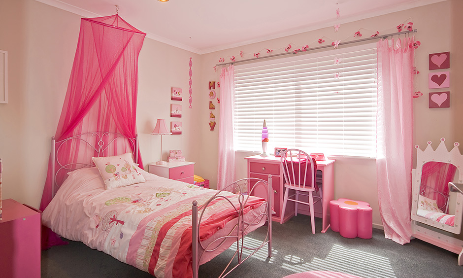 Pink girly DIY room decor with block signages hang around the window lends a beautiful look.