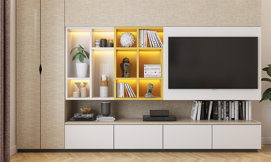 Wooden tv showcase design for hall with sunmica laminates and backlighting enhances the beauty of its design.