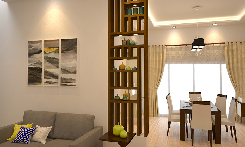 Wooden showcase design for hall with multipurpose and acting as a wooden partition between living and dining area.