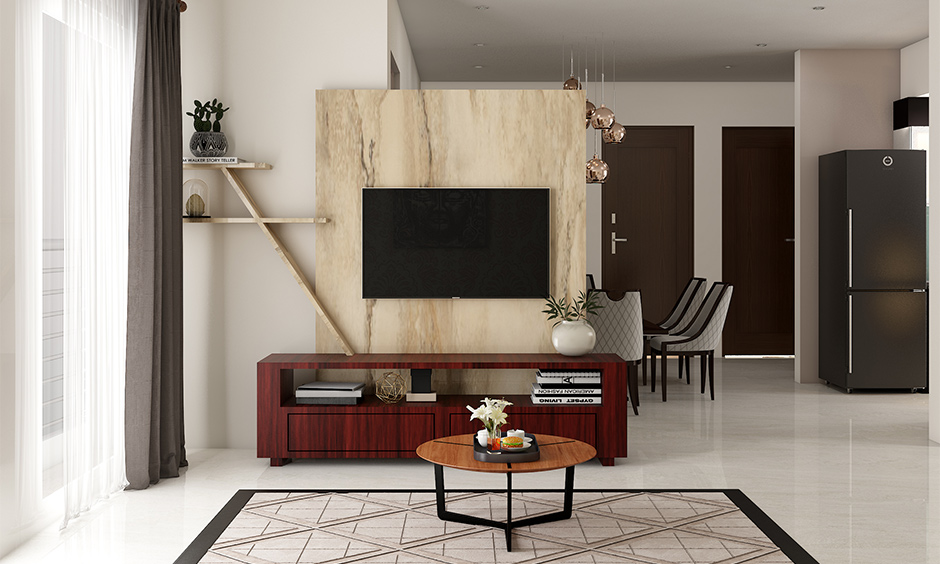 Wooden tv showcase design for hall in a light colour and double up as a partition between living and dining area.