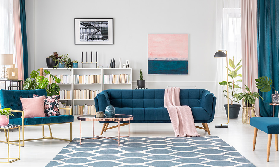 Luxurious sofa sets in ocean blue colour in the white living room is trending sofa design and looks bold.