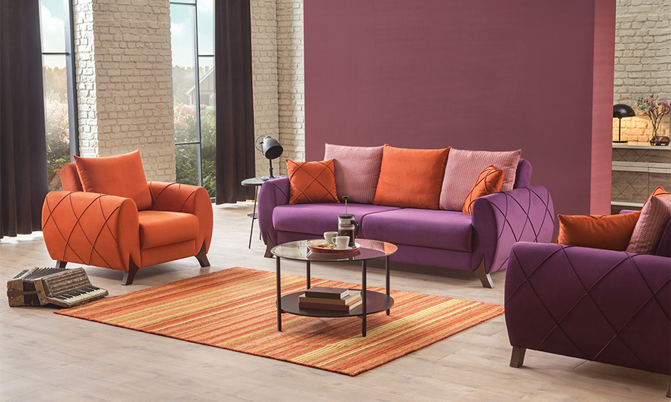 The latest trending sofa set design in a unique shape with intricate detailing in the living room lends a vibrant feel.