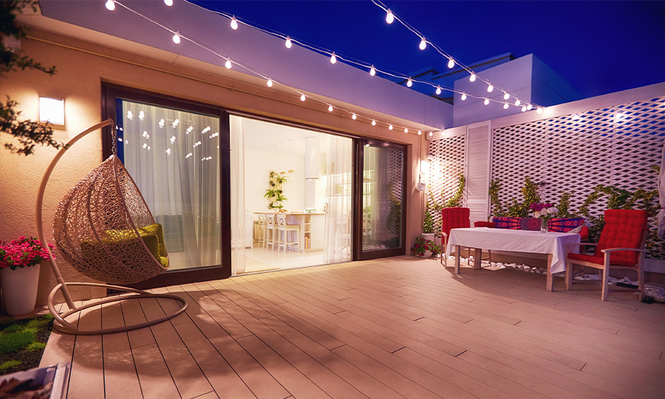 A sliding glass door design with the wooden frame between the patio and living area acts as a beautiful partition.