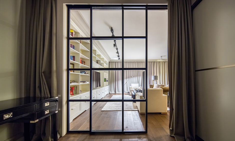 A glass sliding door design for the living room in geometric patterns brings a Japanese vibe to the area.