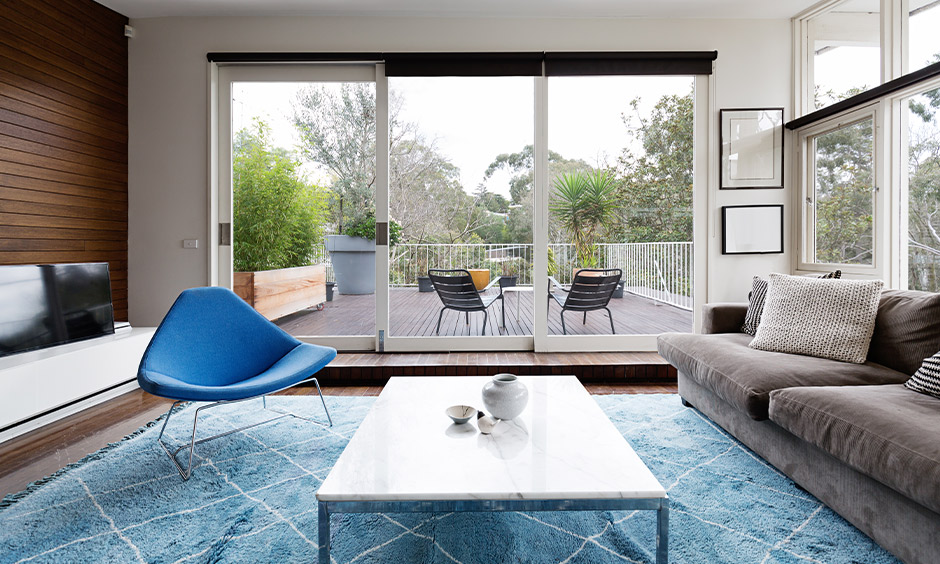 Luxury sliding glass door designed between the living and balcony with clear glass looks spacious.