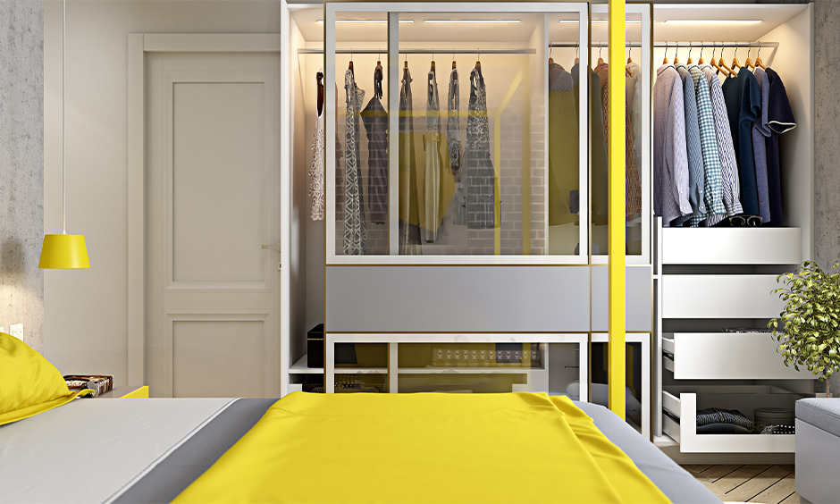 A wardrobe with a modern sliding glass door design in the bedroom lends a luxurious look to space.