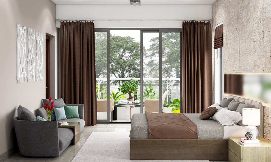 A huge sliding glass door design for the bedroom with a beautiful view of the balcony lends a sleek look.