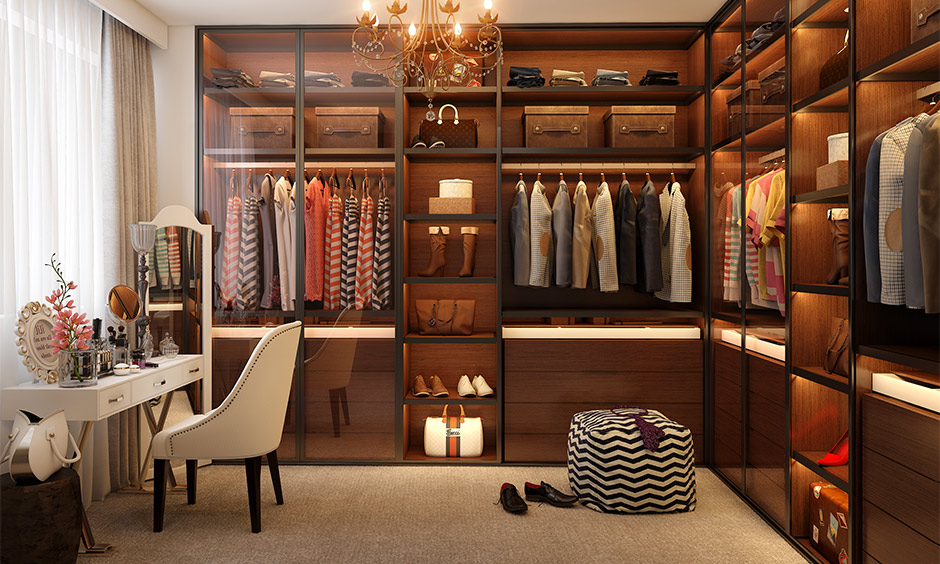 The walk-in wardrobe with a dedicated shoe rack cupboard with a backlight is the best space-saving shoe rack idea.