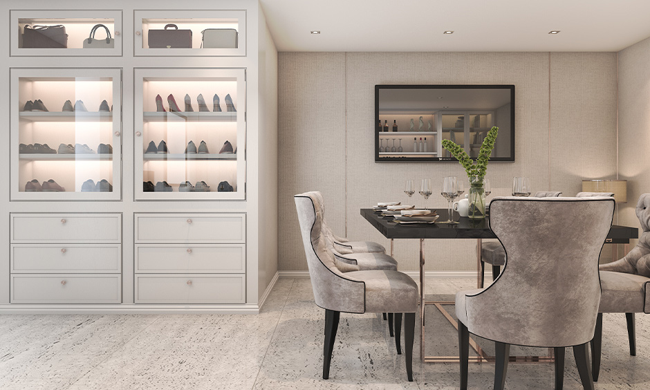 A white space-saving shoe storage rack with a glass door and backlights in the dining room lends a classic look.