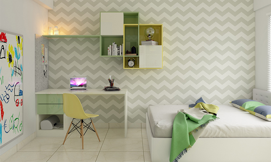 Home decor idea for study room with zig-zag wallpaper and floating open shelf in green and white adds a sleek look.