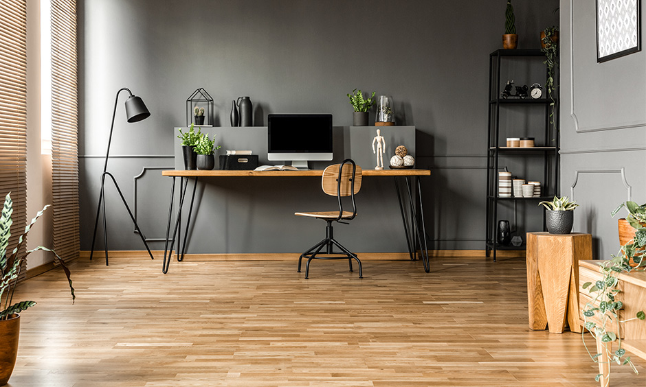 Study room decoration in industrial and natural style with wooden flooring, metal rack and black metal floor lamp.