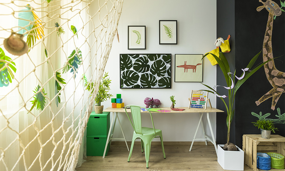 Study room decoration idea, study room decorated with paint art frames, green plants and wall arts bring a natural calmness.