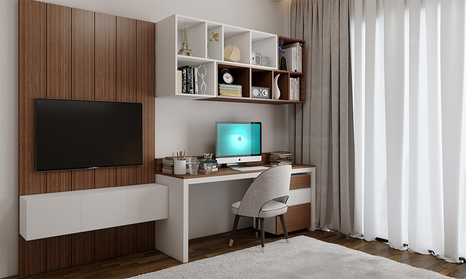 Study room decoration in white and earthy wooden tones add a calming effect with a floating open shelf and tv unit.