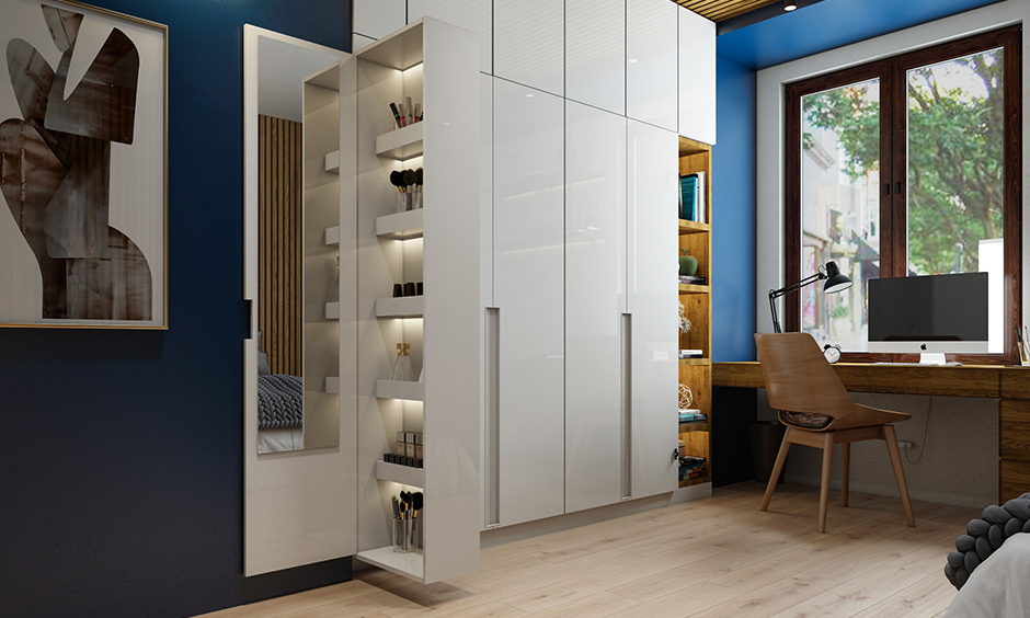 A wardrobe with a hidden dressing table in a minimal design is the best interior gift for a busy mom.