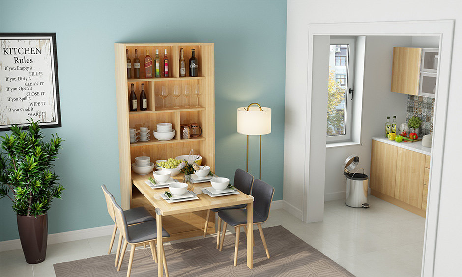 The kitchen cum dining area with wall mounted foldable dining table is the best home interior gift for mom for mother's day.