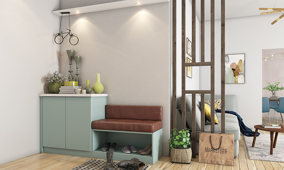 Plain wall and a cluttered cabinet in the foyer area lead to a duller look is the common interior design mistakes.