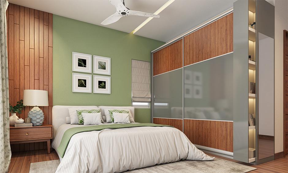 Small bedroom interior mistakes avoid wardrobe with hinged doors instead, use a sliding door.