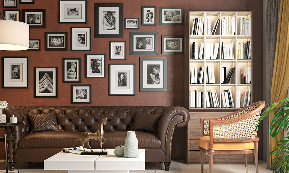 Interior mistakes in the living room with too many photo frames, dark sofa and white centre table look cluttered