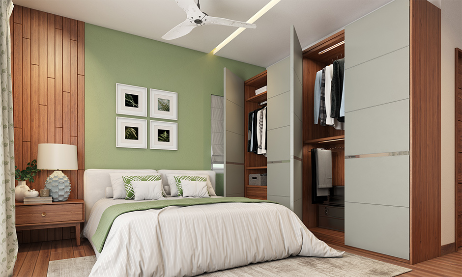 Small bedroom interior mistakes using wardrobe with hinged doors when less space between bed and wardrobe.
