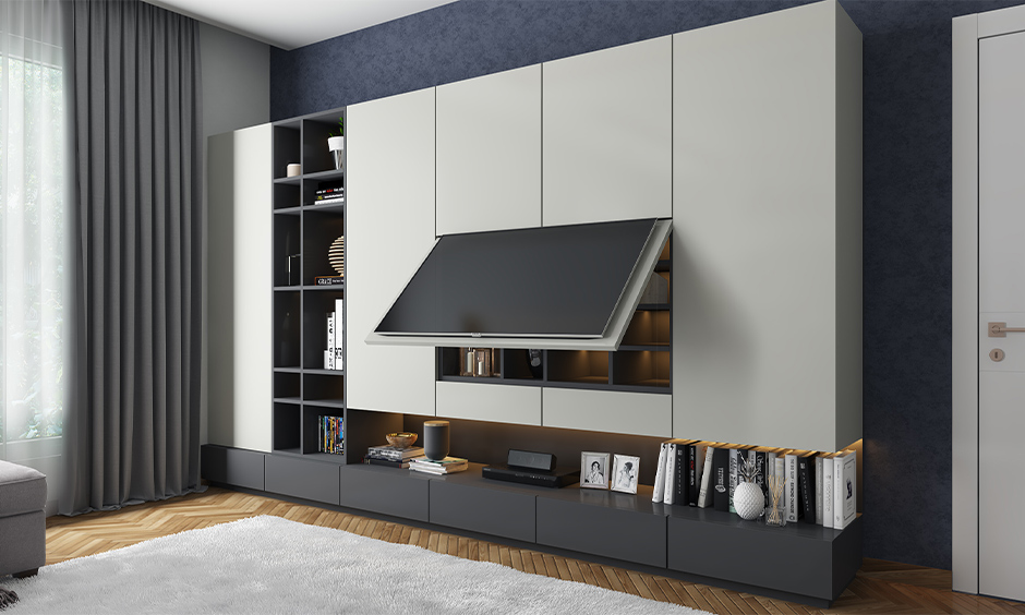 A big tv unit with hidden storage and open shelves is a home entertainment room idea.
