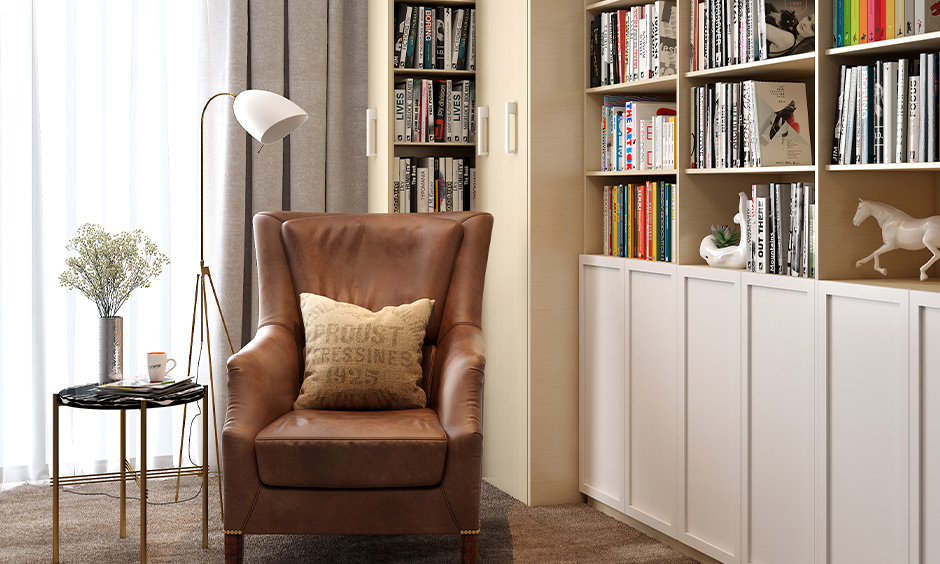 Library small entertainment room idea with open shelves design and armchair brings the relaxing vibe.