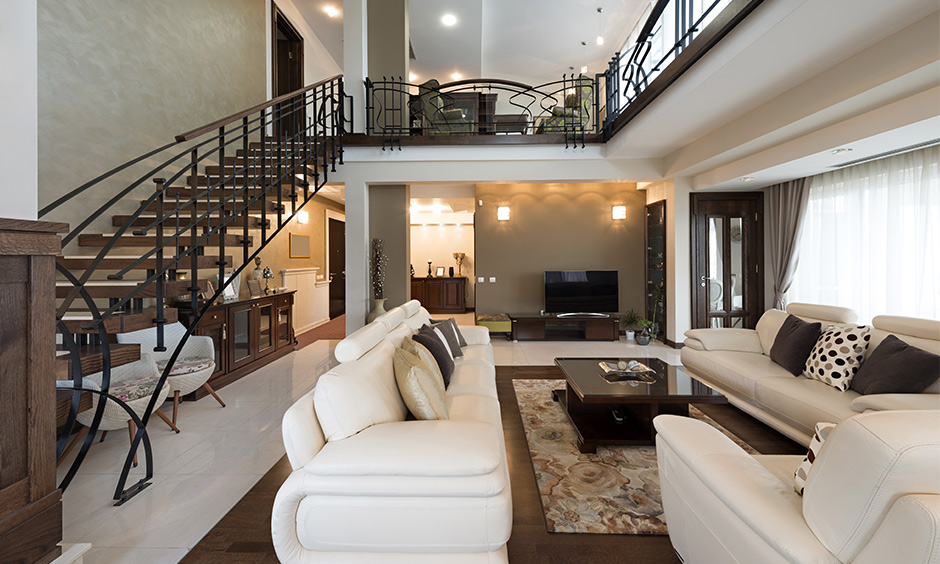 Open plan living room with stairs made from wood with metal brings a traditional vibe to the area.