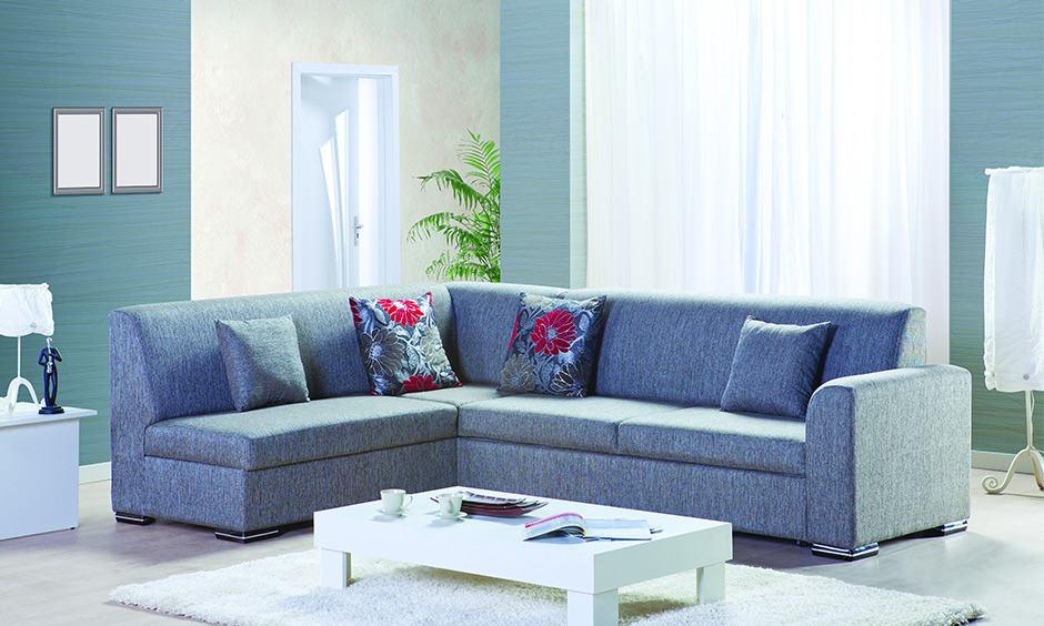 Blue colour themed living room design with a blue fabric corner sofa