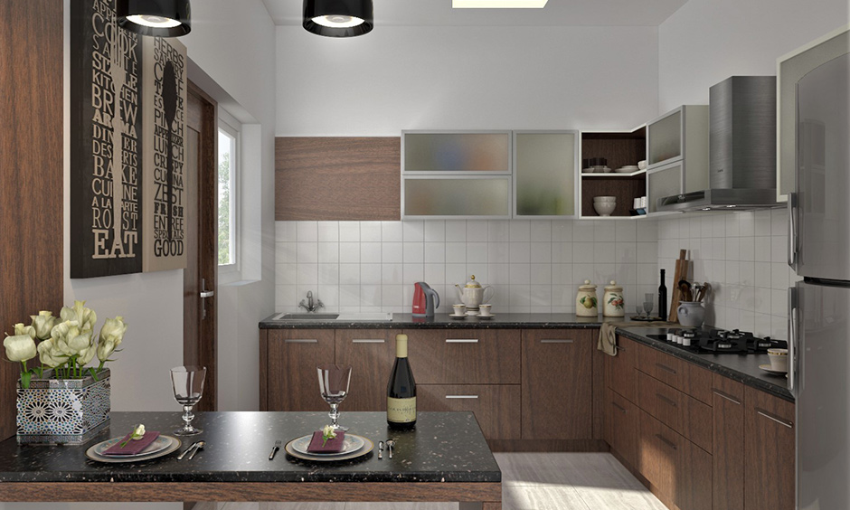 L-shaped kitchen has frosted modern style glass kitchen cabinets, and black pendant light gives a sleek look.