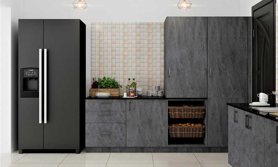 Industrial style kitchen cabinets in grey colour with glossy floor tiles and pendant lights lend a luxurious touch.