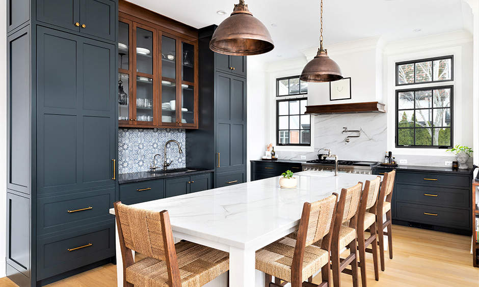 Vintage style kitchen cabinets in dusty blue colour and a marble-top dining table brings an old-school vibe.