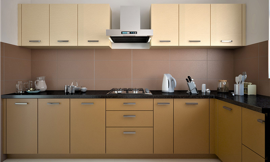 L-shaped kitchen cabinets in simple style and doors in mustard colour brings an airy look to the area.