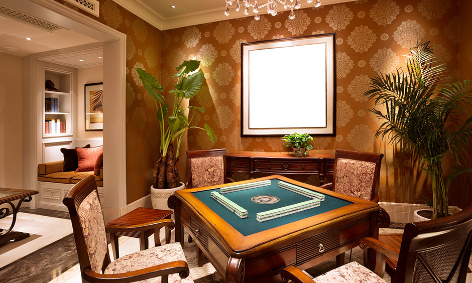 An indoor game room designed with a card table and chairs in a wooden finish create a beautiful ambience.