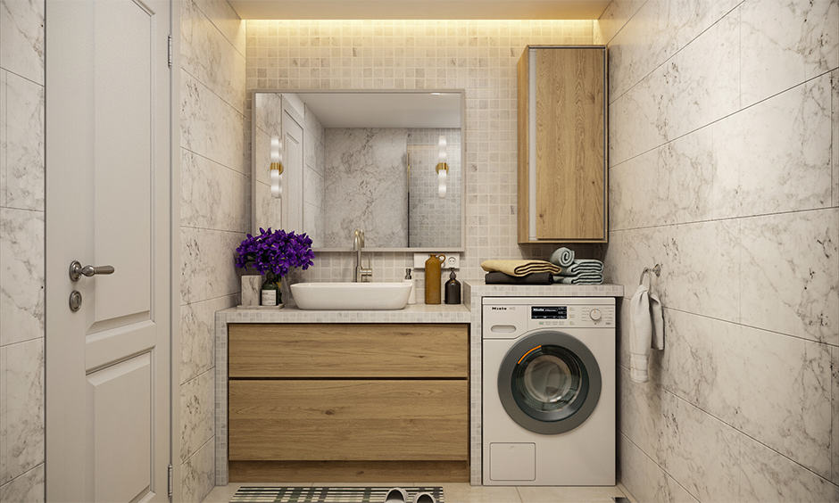 Space-saving bathroom design with a vanity unit and a dedicated space for washing machine