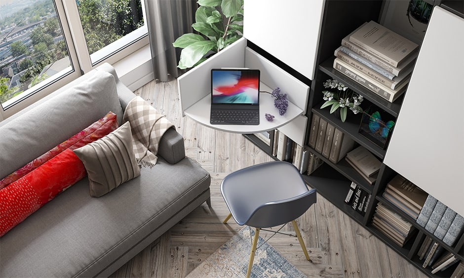 Space saving wardrobe design with a pull out study table for small families