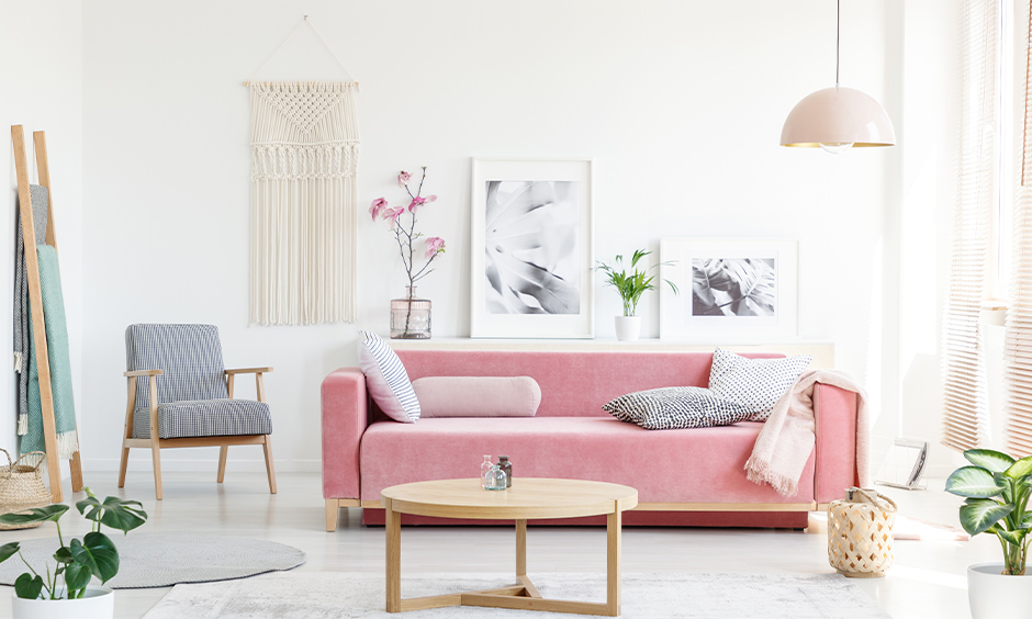 Minimalist Scandinavian living room in white colour with classic furniture and plants adds freshness.
