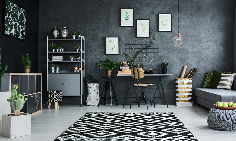 Modern Scandinavian living room with grey wallpapers, indoor plants and wooden furniture brings a classic look.
