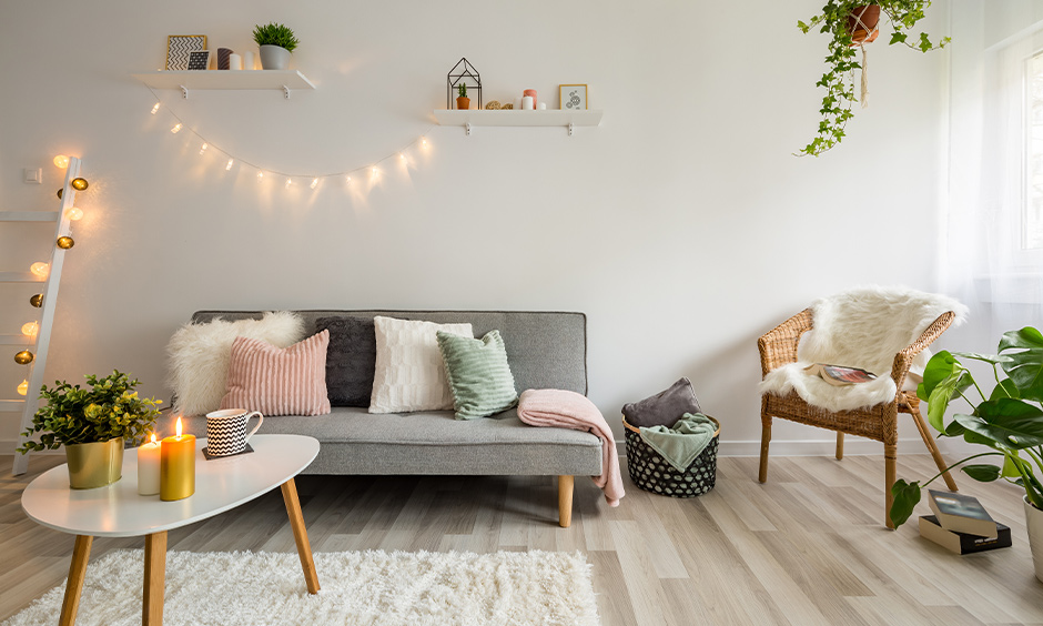 A Scandinavian living room with lighting and candles creates an illusion of a spacious room.