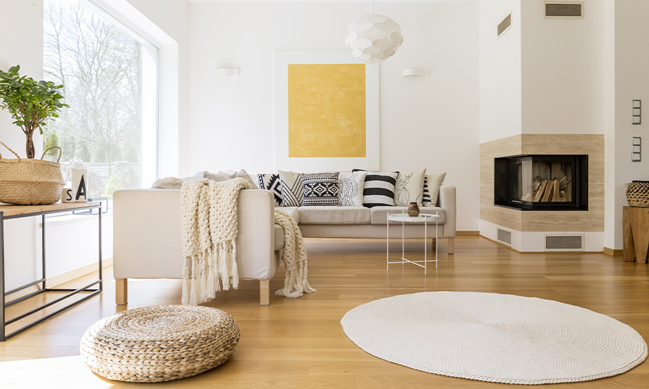 Scandinavian living room design with wooden flooring and minimal wooden furniture adds warmth to the style of interior.