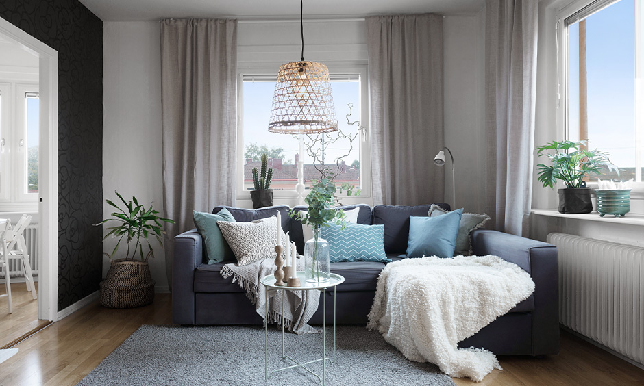 Scandinavian design living room with furniture and indoor plants accentuate the beauty of the living room.