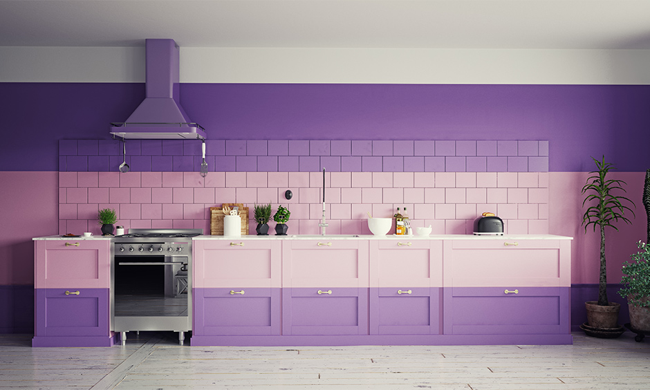 Single-wall kitchen in pink and purple colour combination for studio apartments is the best Indian kitchen interior.
