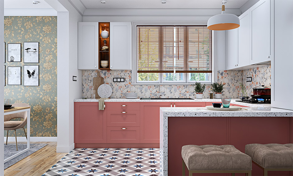 Classic u-shaped Indian kitchen interior with modern breakfast counter and white marble countertop adds a soothing vibe.