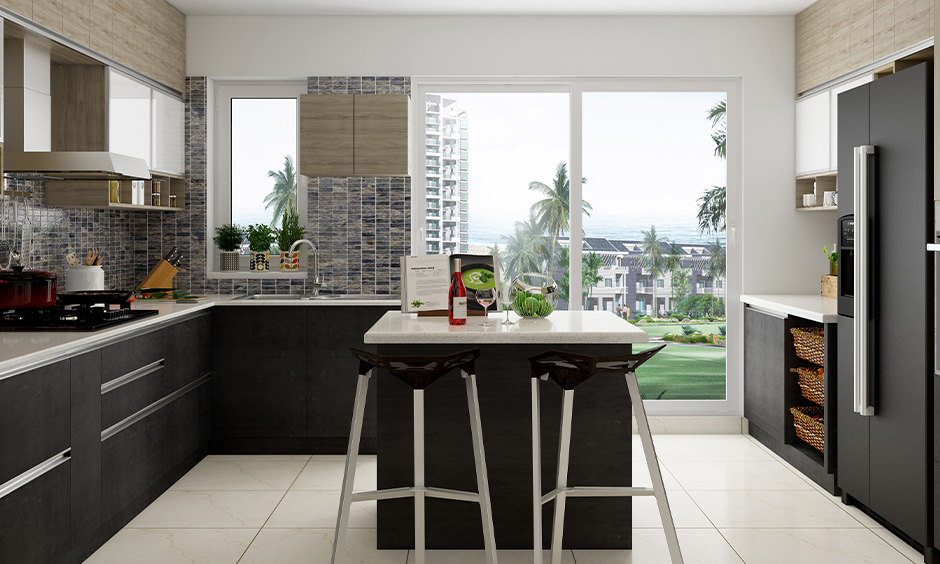 Indian home kitchen interior designed in minimalistic with white countertop and black cabinets creates a unique appeal.