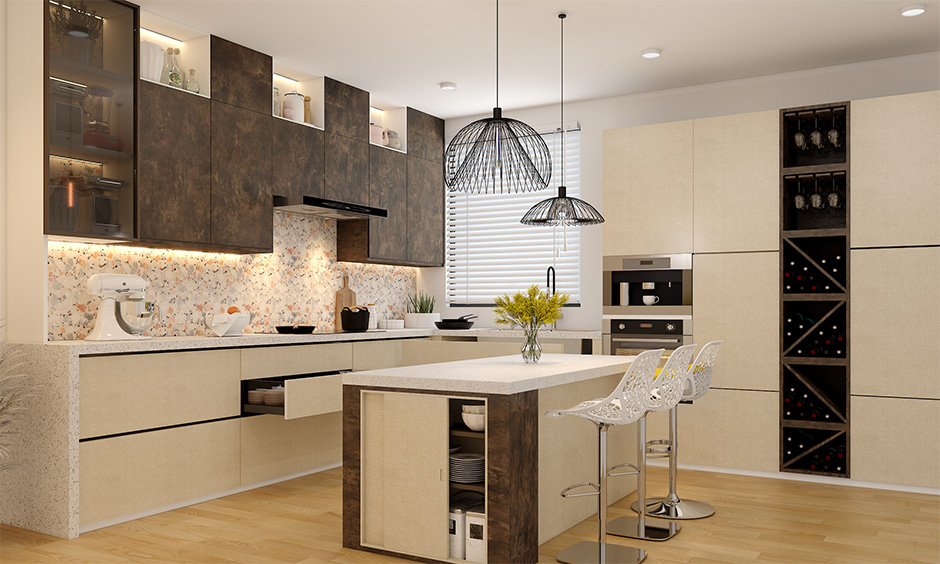 Indian modular kitchen interior designed in island layout with breakfast counter and wine rack lends lavishly.